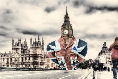 Lord Big Ben dressed in a flag of England, Brexit deal with EU or not deal, United Kingdom Фото со стока