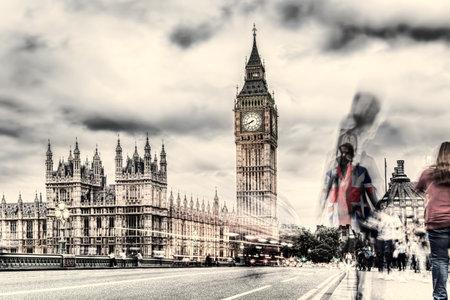 Big Ben with people on bridge in the evening, London, England, United Kingdom Фото со стока