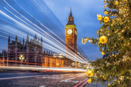 Big Ben with Christmas tree on bridge in the evening, London, England, United Kingdom Фото со стока