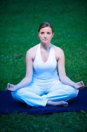 meditates: Cute girl meditates in nature