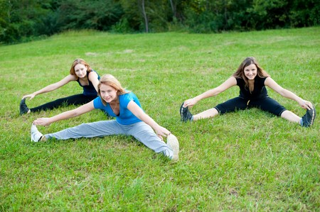 Three girls workout in nature photo