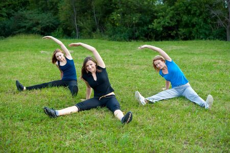 Girls work out in nature photo