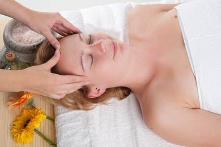 Girl having a massage in wellness center Stock Photo