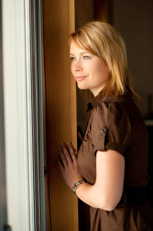 Girl looking through window Stock Photo - 8208129