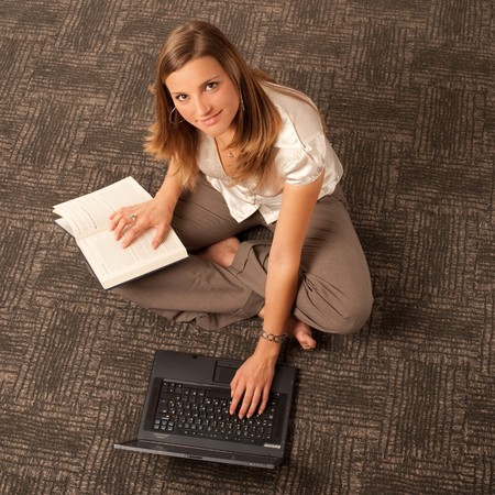 top model: upper view of girl with laptop