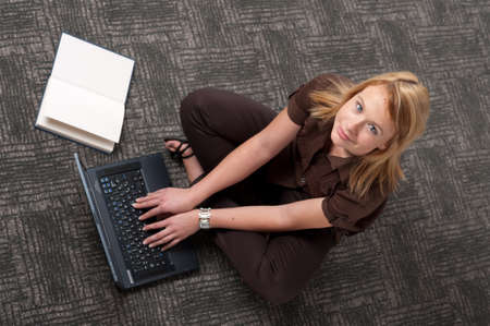 Top view of cute student with book and laptop Stock Photo - 8275257