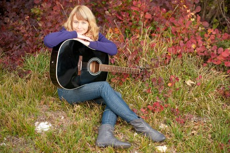 cute young girl with guitar Stock Photo - 8251952