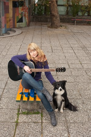 cute young girl with guitar Stock Photo - 8251951