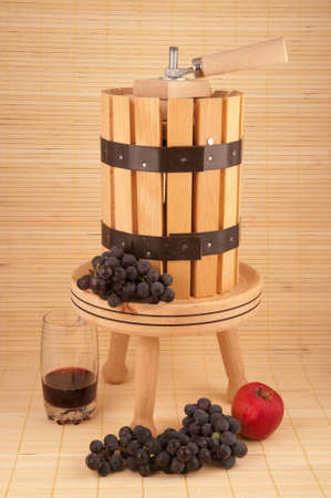 small wooden wine press for pressing grapes to produce wine photo