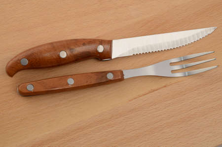 A wooden set of fork and knife photo