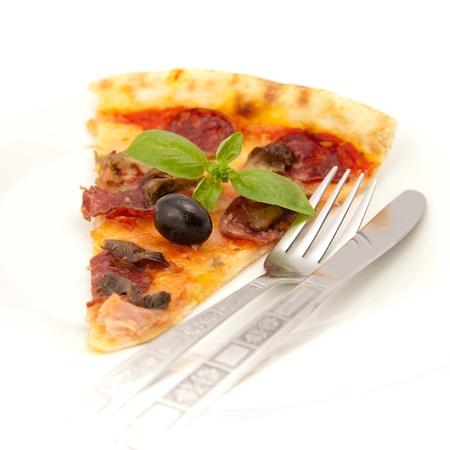 Trozo de pizza sabroso Foto de archivo