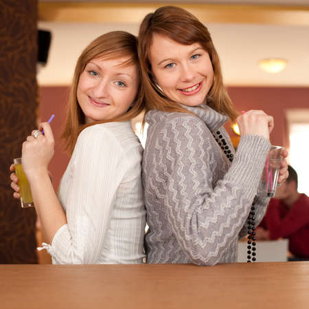 Girl chat - Two girls talking and drinking coffee photo