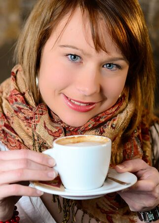 Beautiful young girl dtinking coffee Stock Photo - 9599543