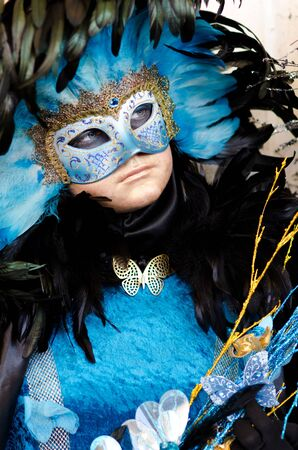 VENICE, ITALY - MARCH 7: Unidentified woman in courtesan mask at St. Mark's Square, Carnival of Venice on March 7, 2011. The annual carnival was held in 2011 from February 26 to March 8, 2011.  Stock Photo - 9777127