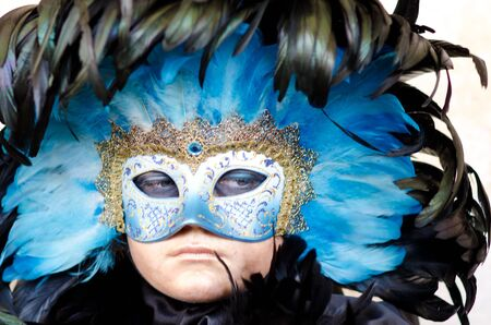 VENICE, ITALY - MARCH 7: Unidentified woman in courtesan mask at St. Marks Square, Carnival of Venice on March 7, 2011. The annual carnival was held in 2011 from February 26 to March 8, 2011.