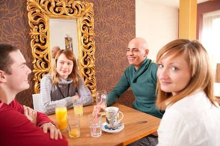 Man just arrived in a caffee where three girls were expecting him photo