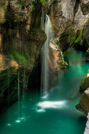 Small waterfal in Soca river valey Slovenia photo