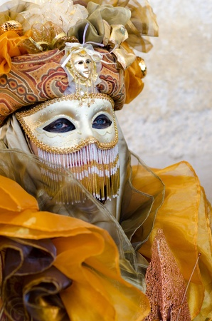 mardigras: VENICE, ITALY - MARCH 7: An unidentified masked person pose in front of St. Mark church in Venice, during the annual Venice carnival. on March 7, 2011.