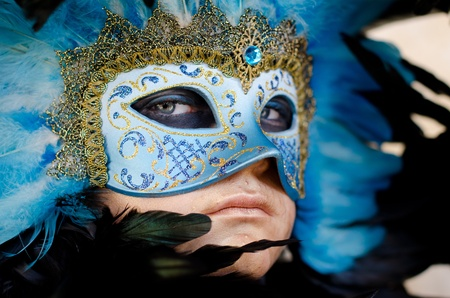 VENICE, ITALY - MARCH 7: An unidentified masked person pose in front of St. Mark church in Venice, during the annual Venice carnival. on March 7, 2011.  Stock Photo - 10006334