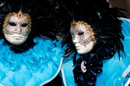 mardigras: VENICE, ITALY - MARCH 7: An unidentified masked couple pose in front of St. Mark church in Venice, during the annual Venice carnival. The carnival is from February 26 - March 8, 2011.