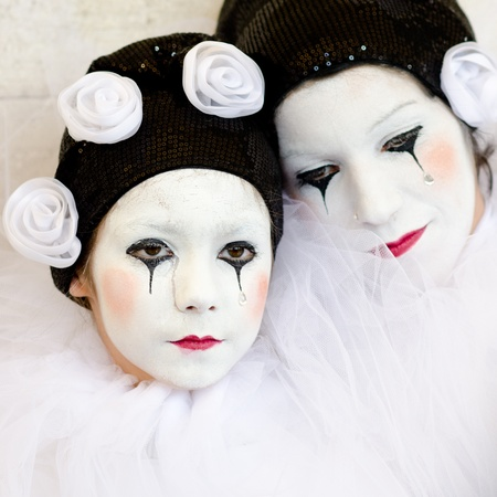 VENICE, ITALY - MARCH 7: An unidentified masked woman and child pose in front of St. Mark church in Venice, during the annual Venice carnival. The carnival is from February 26 - March 8, 2011.