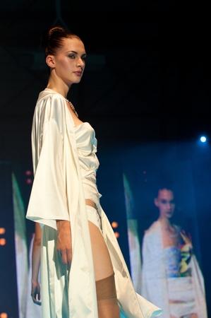 crearion: IDRIJA, SLOVENIA - JUNE 18: Model walks the runway in Alica Underwear with idria lace at the Idrija Lace Festival Fashion Show on June 18, 2011. The festival is from June 17 - 20, 2011