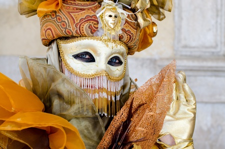 VENICE, ITALY - MARCH 7: Unidentified woman in Venice mask at St. Marks Square, Carnival of Venice on March 7, 2011. The annual carnival was held in 2011 from February 26 to March 8, 2011.
