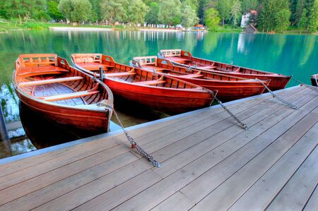 moorings: Boats on alpine lake in early morning Stock Photo