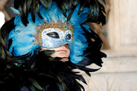 VENICE, ITALY - MARCH 7: Unidentified people in Venetian masks at St. Marks Square, Carnival of Venice on March 7, 2011. The annual carnival is from February 26 to March7, 2011.
