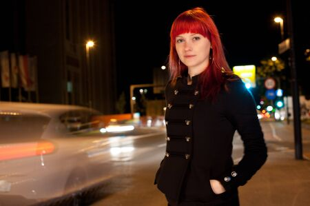 Young sexy girl on street at night photo