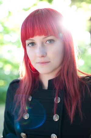 Attractive young girl with red hair photo