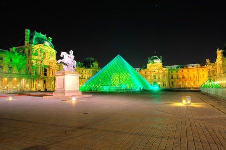 PARIS - SEPTEMBER 25: Louvre Pyramid shines at night during the autumn  September 25, 2011 in Paris. Louvre is the biggest Museum in Paris displaying over 60,000 square meters of exhibition space. Stock Photo - 10808164