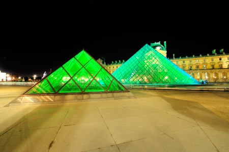 PARIS - SEPTEMBER 25: Louvre Pyramid shines at night during the autumn  September 25, 2011 in Paris. Louvre is the biggest Museum in Paris displaying over 60,000 square meters of exhibition space. Stock Photo - 10808161