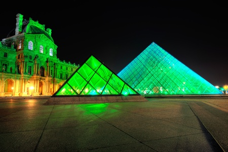 PARIS - SEPTEMBER 25: Louvre Pyramid shines at night during the autumn  September 25, 2011 in Paris. Louvre is the biggest Museum in Paris displaying over 60,000 square meters of exhibition space. Stock Photo - 10808169