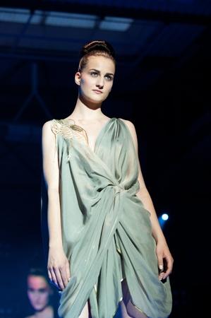 17 20: IDRIJA, SLOVENIA - JUNE 18: Model walks the runway in Urska P. & Tanja P.   creation with idria lace at the Idrija Lace Festival Fashion Show on June 18, 2011. The festival is from June 17 - 20, 2011