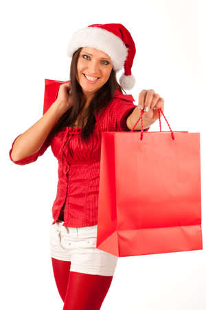 beautiful girl dressed like Santa with Christmas presents Stock Photo - 11396087