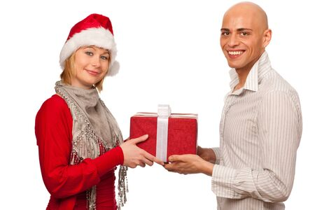 Christmas gift - Girl in santa dress giving a gift to a man Stock Photo - 11396089