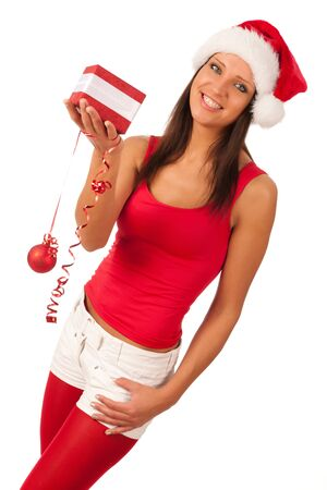 beautiful girl dressed like Santa with Christmas presents photo