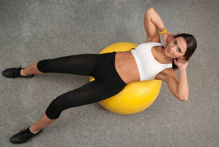 Beautiful young woman working out in fitness club Stock Photo