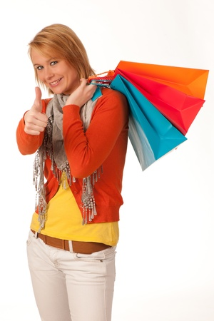 isoleted: cheerful young woman with shopping bags isoleted on  white background Stock Photo