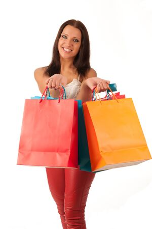cheerful young woman with shopping bags isoleted on  white background photo