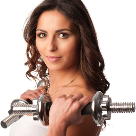 free weight: Young fit girl working out with weights - Portrait of pretty young woman lifting dumbbells during exercising