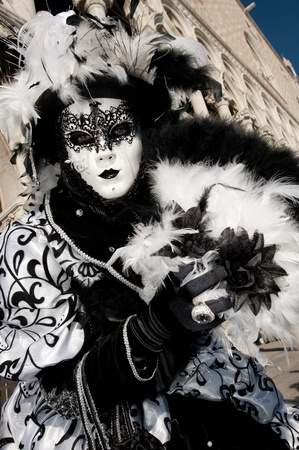 VENICE, ITALY - FEBRUARY 26: Unidentified person in Venetian masks at St. Mark's Square, Carnival of Venice on February 16, 2012 in Venice, Italy. The annual carnival is from February 11 to February 21, 2012. Stock Photo - 12272291