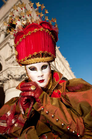 VENICE, ITALY - FEBRUARY 26: Unidentified person in Venetian masks at St. Marks Square, Carnival of Venice on February 16, 2012 in Venice, Italy. The annual carnival is from February 11 to February 21, 2012.