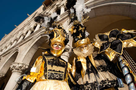 mardigras: VENICE, ITALY - FEBRUARY 26: Unidentified people in Venetian masks at St. Marks Square, Carnival of Venice on February 16, 2012 in Venice, Italy. The annual carnival is from February 11 to February 21, 2012. Editorial