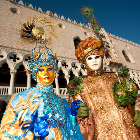 VENICE, ITALY - FEBRUARY 26: Unidentified people in Venetian masks at St. Mark's Square, Carnival of Venice on February 16, 2012 in Venice, Italy. The annual carnival is from February 11 to February 21, 2012.