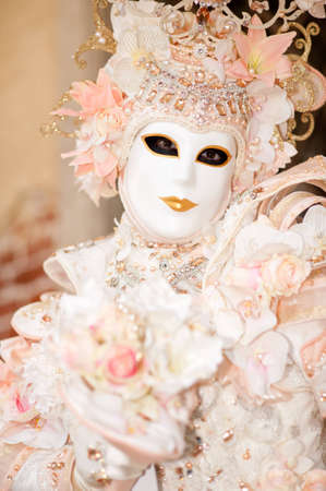 VENICE, ITALY - FEBRUARY 26: Unidentified person in Venetian masks at St. Mark's Square, Carnival of Venice on February 16, 2012 in Venice, Italy. The annual carnival is from February 11 to February 21, 2012. Stock Photo - 12272294
