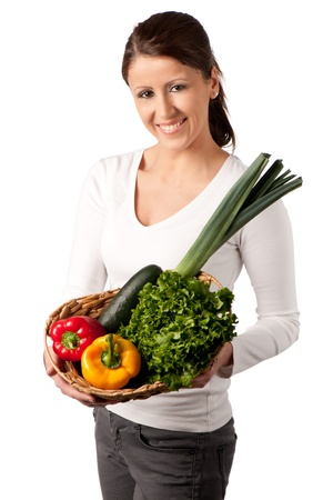 Attractive young woman with basket of vegetables photo