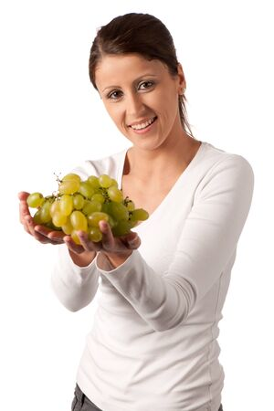 Attractive young woman with white grape un her hand Stock Photo - 12987515