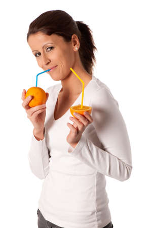 Attractive young woman with glass of orange juice Stock Photo - 12987510